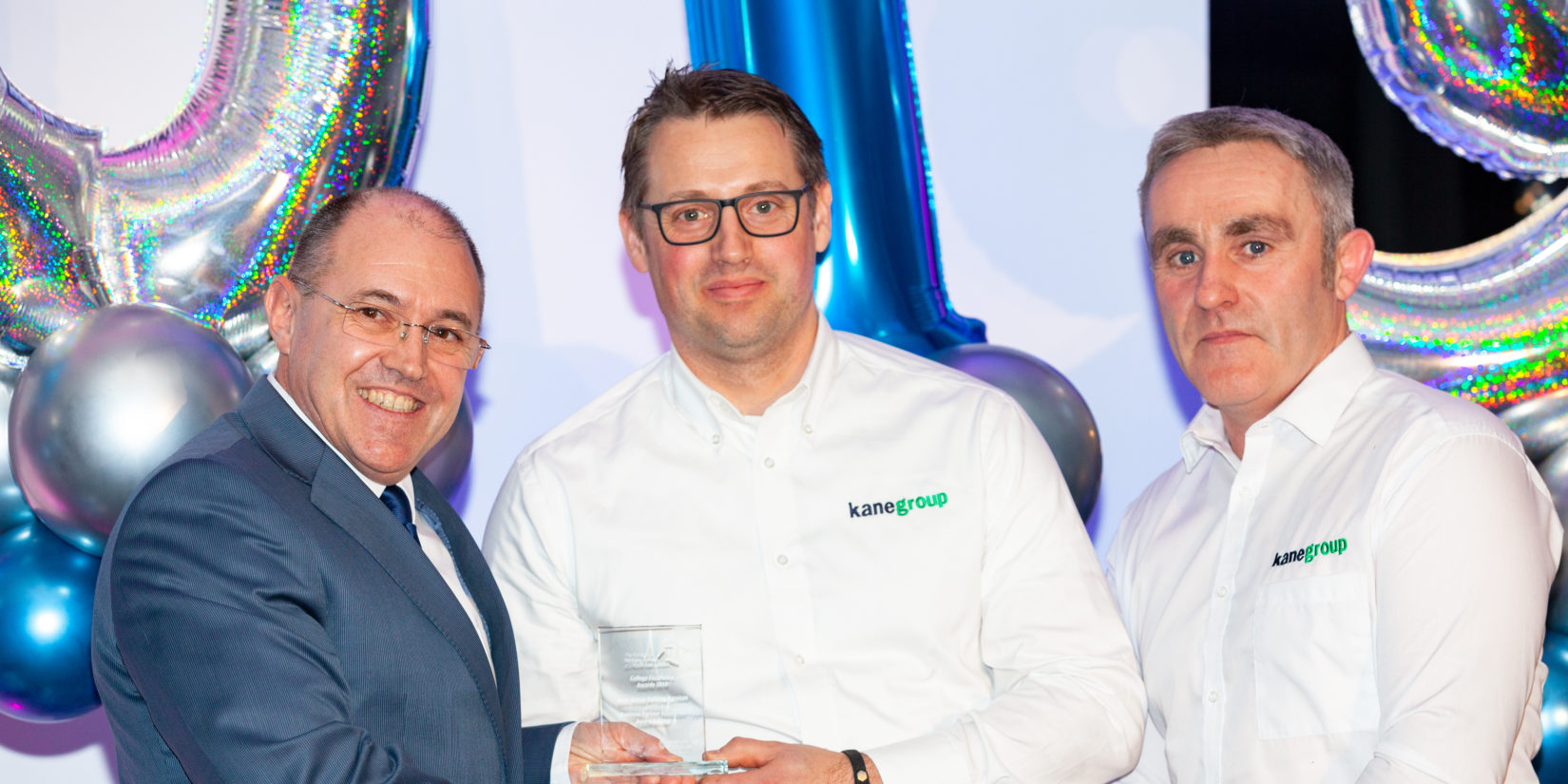Pictured L-R: CONEL Principal Kurt Hintz presenting the award to Craig Smith and John McMullan from Kane.